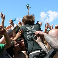 geoff rickly of thursday dives in the crowd at warped tour 2006