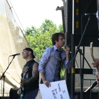 """bouncing souls with a sign that says """"i wanna have your babies"""""""