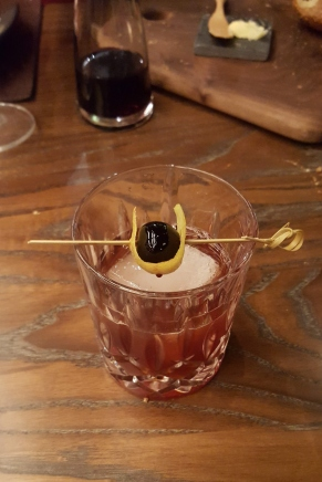 The notorious High Noon cocktail, consisting of bourbon, tequila, cherry heering, cinnamon syrup, orange and angostura bitters as per https://www.dbgb.com/content/pdfs/dbgb-dc-wine-list-1-8-19.pdf